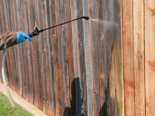 In the process of cleaning a fence