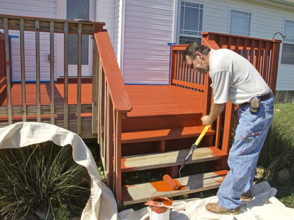 Man staining a deck