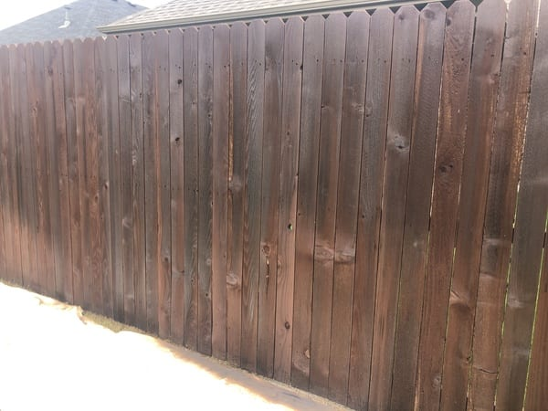 Another fence section during the staining