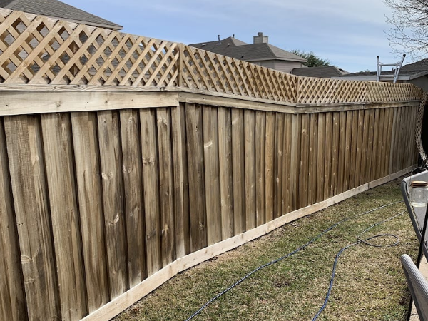 Fence unstained because it isn't the best time to stain a fence