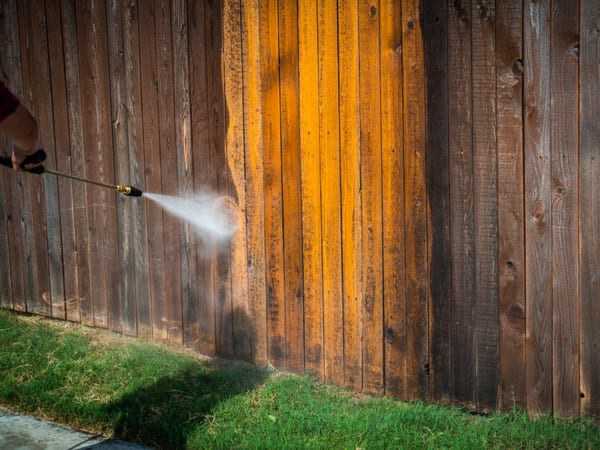Power wash fence before stain