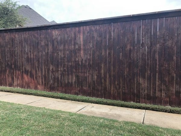 Wood fence with damage to stain
